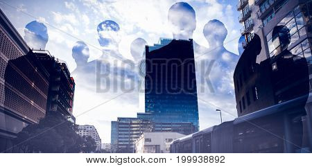 Silhouettes standing against cityscape against cloudy sky