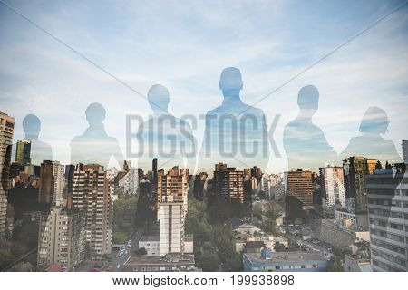 Business people standing against white background against city against blue sky