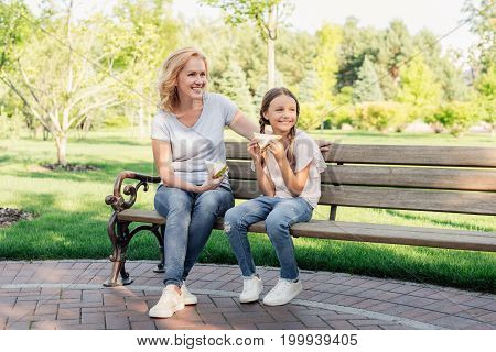 Woman And Granddaughter Eating Sandwiches