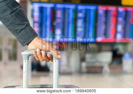 Young man traveler with carrying hold suitcase luggage and passenger for tour travel booking ticket flight in airport international vacation time in holiday rest and relaxation.rest and relaxation.