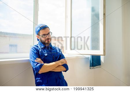 Construction worker trying to solve some problem