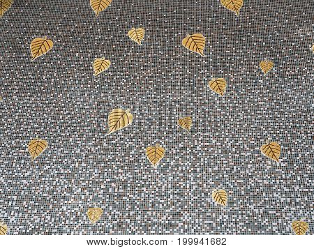 Mosaic tile wall with the golden bothi tree in the Traditional Thai style of the Thai church.(Public area not required Property Release)