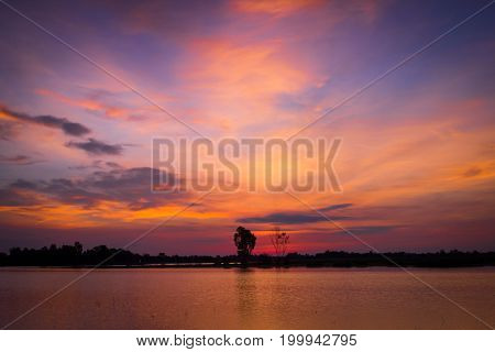 Morning sky or twilight sky before sunrise at a lake in rural Thailand. Landscape background.
