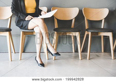 Young woman waiting for job interview.  Business Concept