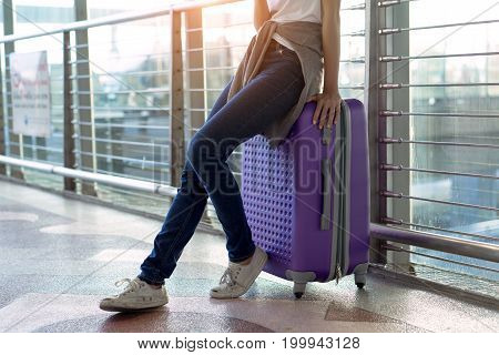 Young girl traveler with carrying hold suitcase luggage and passenger for tour travel booking ticket flight in airport international vacation time in holiday rest and relaxation.