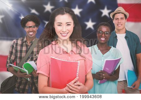 Stylish students smiling at camera together against close-up of red and white american flag