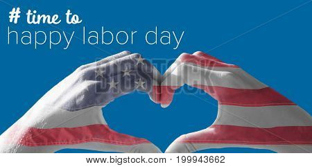 Hands making heart shape on the beach against american national flag with stars and stripes