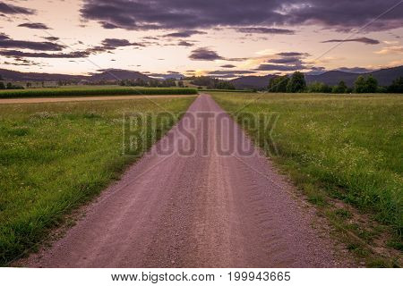 Beautiful sunset  sky with country road .