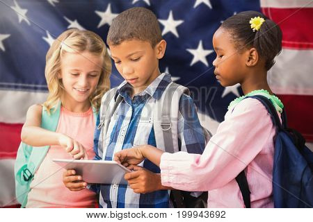Students using digital tablet  against close-up of red and white american flag