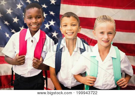 Portrait of students in uniforms against close-up of an flag