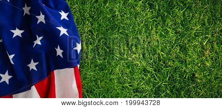 Star shapes on striped American flag against close-up of grass mat