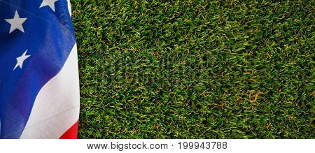 Close-up of American flag against close-up of grass mat