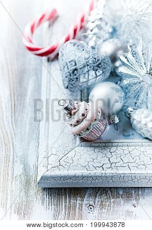 Christmas ornaments on a white frame