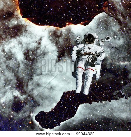 Astronaut In Outer Space. Nebula On The Background.