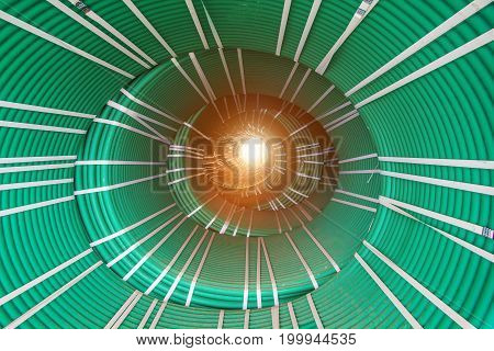 Abstract creative tunnel vision from packs of twisted green hoses