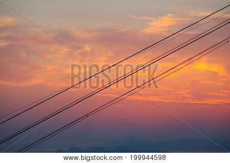 The cable car wires at sunset background.