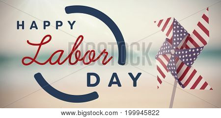 Digital composite image of happy labor day text with blue outline against pair of wedding ring on sand