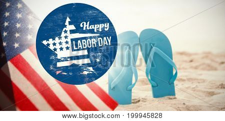 Digital composite image of happy labor day text on blue poster against blue flip flop in sand