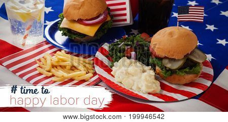 Digital composite image of time to happy labor day text against salad and burger in plate on american flag