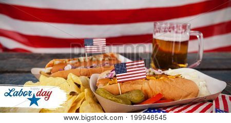 Digital composite image of happy labor day text with star shape against hot dog and potato chips with fourth of july theme