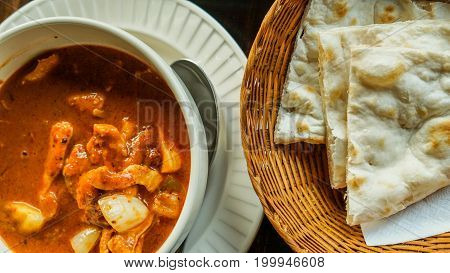 Indian Cuisine Red Curry And Nan Bread