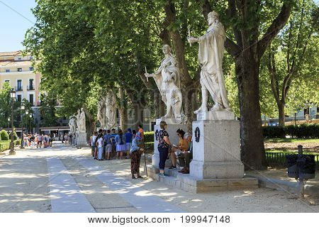MADRID, SPAIN - MAY 24, 2017: It is an alley with limestone statues of Spanish kings on Plaza Oriente.