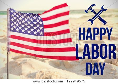 Digital composite image of happy labor day text with tools against close-up of sand surface