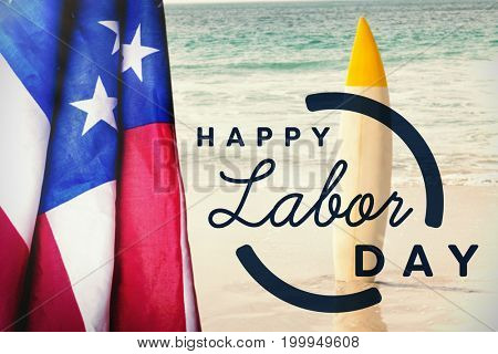 Digital composite image of happy labor day text with blue outline against surfboard in sand