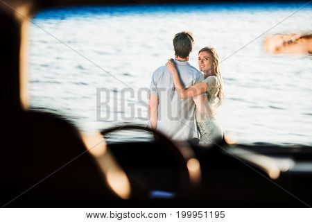 Young Couple At Riverside