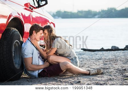 Sensual Couple Near Car