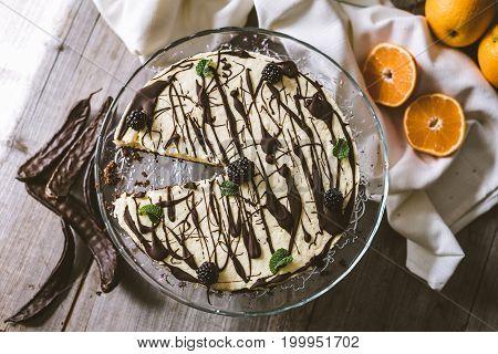 Vegan orange cake with carob on rustic background