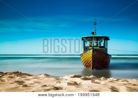 Standing on the beach fishing boat on the Baltic Sea