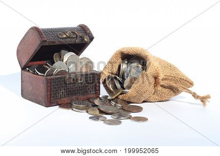 Thai Baht coins in bags and wooden boxes