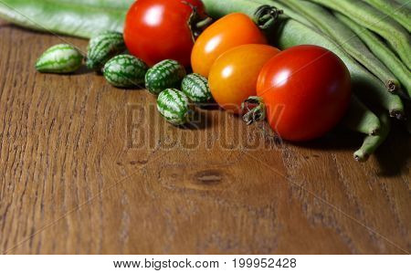 Cucamelons With Red And Orange Tomatoes And Runner Beans