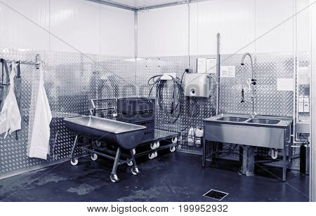 Modern dishwashing room at food processing plant, toned image