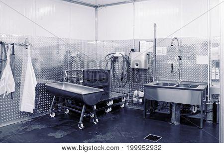 Modern dishwashing room at food processing plant, toned image