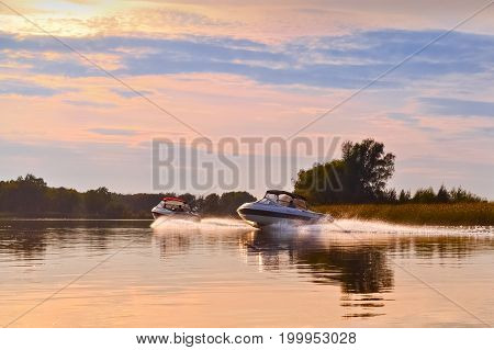 Autumn River landscape at sunset with boats
