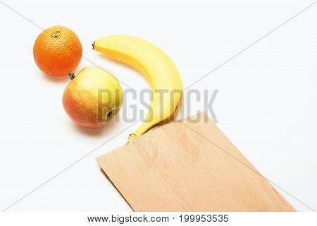 Banana, Apple And Orange Fruit In Paper Package