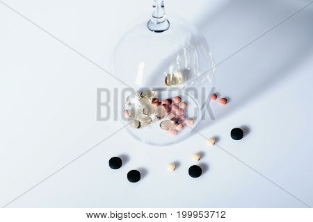 Capsule And Various Pills Inside Wineglass