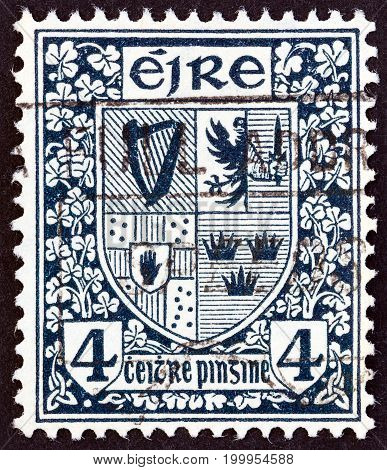 IRELAND - CIRCA 1922: A stamp printed in Ireland shows Arms of the four provinces, circa 1922.