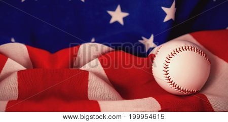 Close-up of baseball ball on crumbled national flag