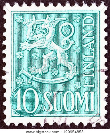 FINLAND - CIRCA 1954: A stamp printed in Finland shows National arms emblem, circa 1954.