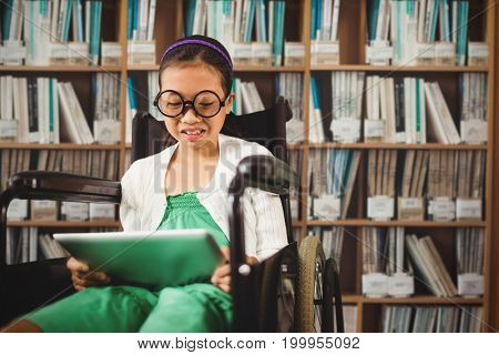 Young girl looking at digital tablet against various multi colored books on shelf