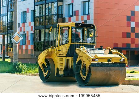 Road Roller Working At Road Construction Site In The City