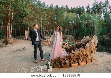 Newlyweds Holding Hands, Laugh And Smile, Happy And Joyful Moment. Bride And Groom Walking On Nature