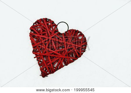 red handmade valentine heart isolated on white background top view