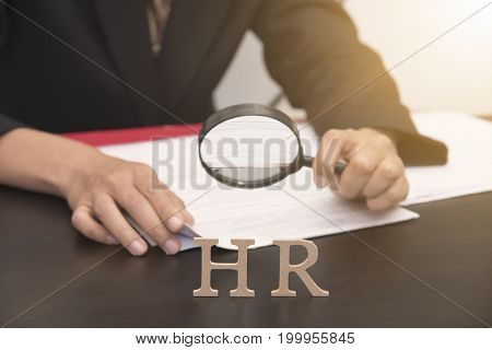 business employer holding magnifying glass searching. concept HR and interview hiring.
