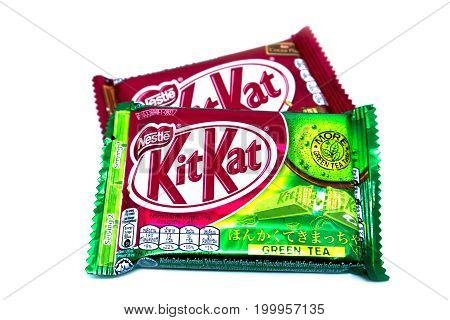 Kota Kinabalu Malaysia - August 16 2017: Kit Kat Chocolate Milk Wafer and Green Tea flavored isolated on white background. Kit Kat bars are produced by Nestle. Brand Kit Kat was registered in 1911.