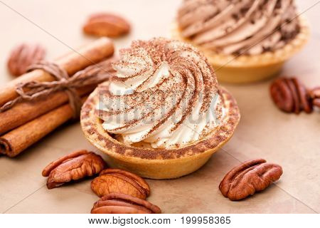 Delicious mini tarts with whipped cream and pecans.