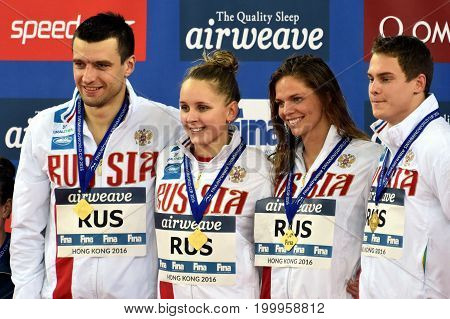 Hong Kong China - Oct 30 2016. Winner team Russia (MOROZOV Vladimir DONETC Stanislav USTINOVA Daria EFIMOVA Yuliya) at the Victory Ceremony of the Mixed Freestyle 4x50m. FINA Swimming World Cup